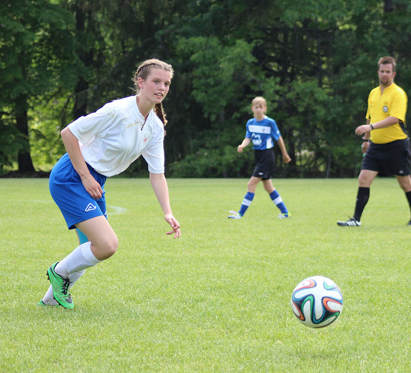 Mia Playing soccer